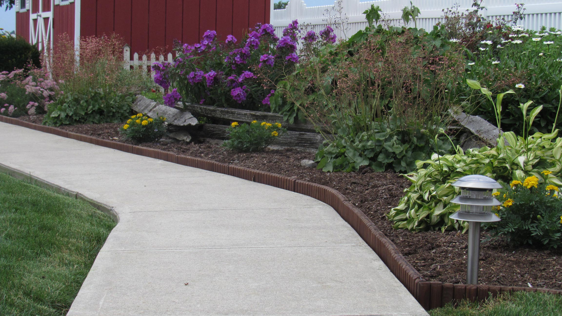 Brown landscape edging natural looking wood edging for Creating a landscape